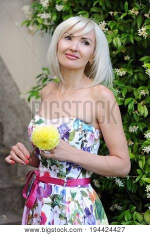 beautiful blond with yellow flower