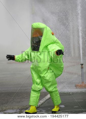 Green Protective Suit With Air Filtering System To Breathe Durin