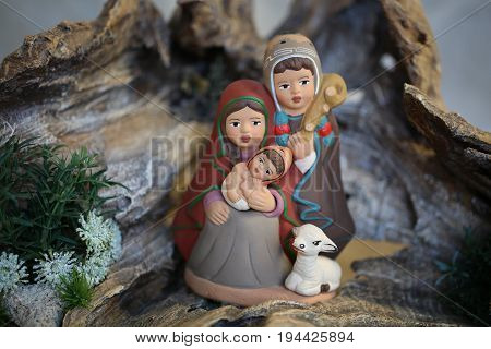 Peruvian Family With White Sheep With Winter Clothes In Latin Am