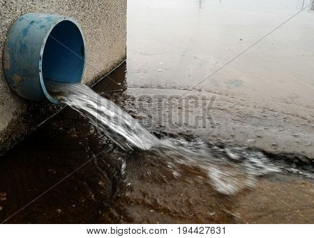 water emanate from blue pipe for background