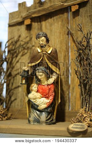 Nativity Scene With The Holy Family And Saint Joseph Who Holds A