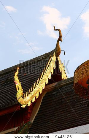 gable of temple in northern region Thailand  artistic wood crafted detail decoration on temple gable northern region Thailand style.
