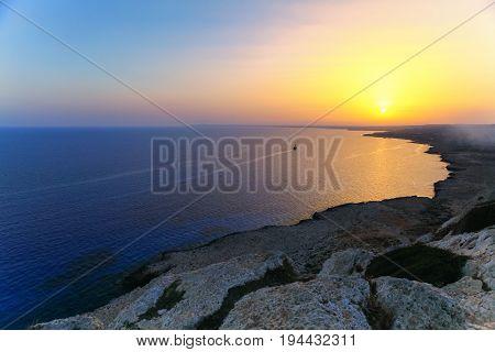 Beautiful sunrise with ship on the sea on Aya Napa Cyprus