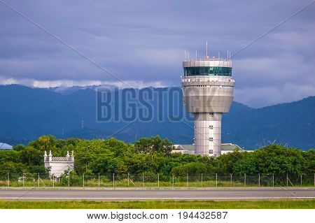 Airport control tower at Kota Kinabalu International Airport Sabah,Malaysia.ATC purpose is to prevent collisions,organise & expedite the flow of air traffic,& provide information & other support for pilots.