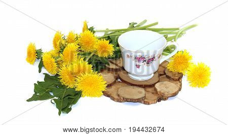 A Bouquet Of Fresh Dandelions Yellow Hats  Near A Tea Pair From A Saucer Cup  Porcelain Service On A