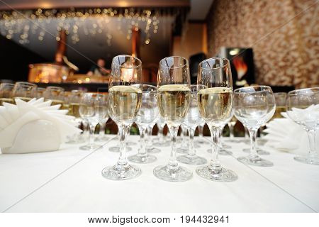 Glasses with champagne on the white table