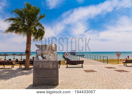 LARNACA CYPRUS - MAY 29 2014 : View on the Winged Lion statue on the promenade at Foinikoudes in the south coast town of Larnaca on the Mediterranean island of Cyprus.