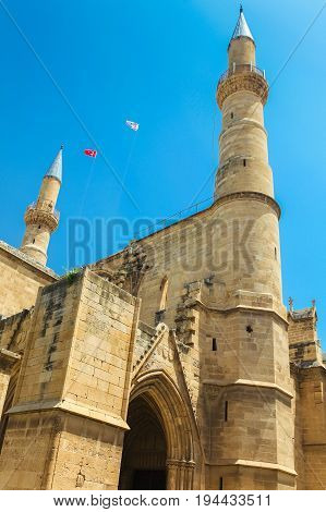 NICOSIA NORTHERN CYPRUS - MAY 30 2014: View on The Selimiye mosque (ex. St. Sophia Cathedral) and flags of Turkey and Northern Cyprus