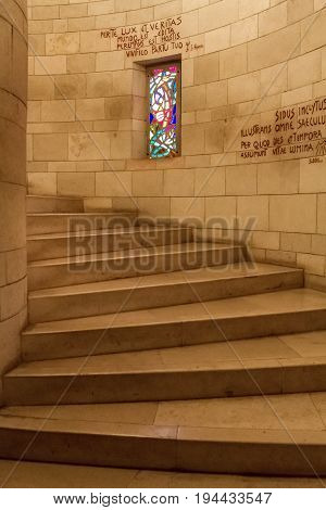 NAZARETH, ISRAEL - DECEMBER 11: Stone staircase and stained glass window, interior of the Basilica of the Annunciation or Church of the Annunciation in Nazareth, Israel on December 11, 2016