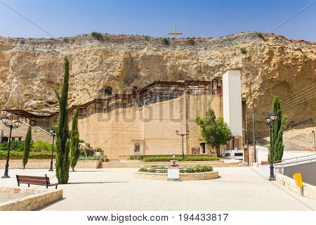 Dheftera Nicosia CYPRUS - MAY 30 2014 : View on the Panagia Chrysospiliotissa Church. The church of Panagia Chrysospiliotissa is built in the natural sandstone cave in which were formed an apse a nave narthex and vestries