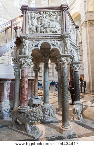 Pisa, Italy - April 07, 2017: The pulpit of Nicola Pisano in the Pisa Baptistery of St. John in the Piazza dei Miracoli near the Duomo