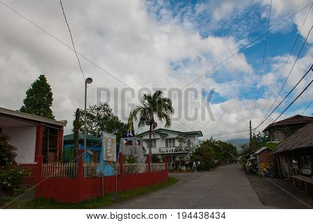 Rural Road With Houses And Transport In The Philippines. Pandan, Panay