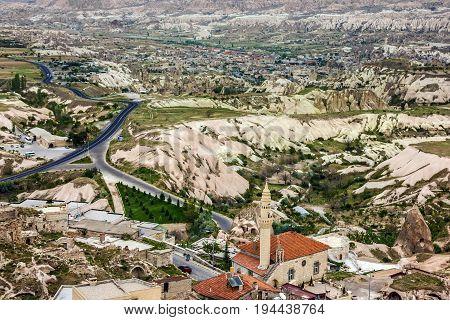 Cappadocia, view on mosque of town Goreme, Turkey