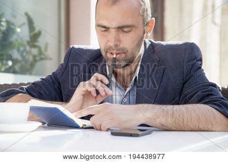 businessman planning his workday. Time management concept. (Freedom freelance success money concept)