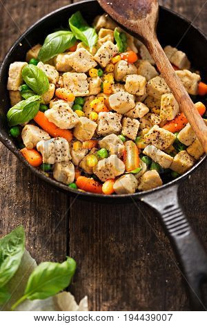 Vegetarian meat free pieces (mycoprotein) with vegetables on iron cast