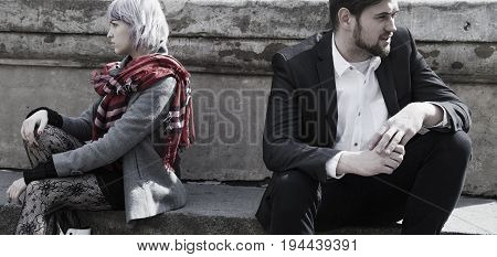 Young couple is having a quarrel. (Love hate unhappy stress negative emotion concept)