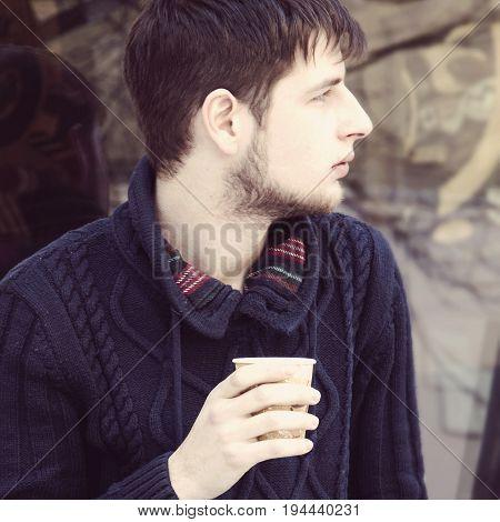 Coffee Break. Sucessful young man enjoying in a cup of coffee