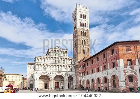 Lucca Italy - April 07 2017: Lucca Cathedral of St. Martin and bell towe