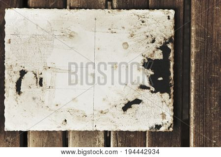 Blank vintage postcard and envelope on old wooden background. Retro styled. (place for text)
