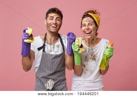 Joyful Happy Family Couple Clenching Their Fists With Excitement Being Glad To Clean All Rooms Of Th