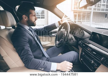 Young business person test drive new vehicle angry
