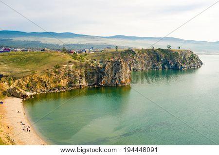Rocky coast and beach near the village of Khuzhir in the evening. Olkhon Island, Lake Baikal, Siberia, Russia