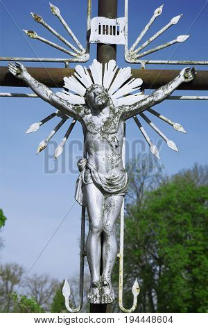 the crucifixion of Jesus Christ as a symbol of God's love (Old metal statue)