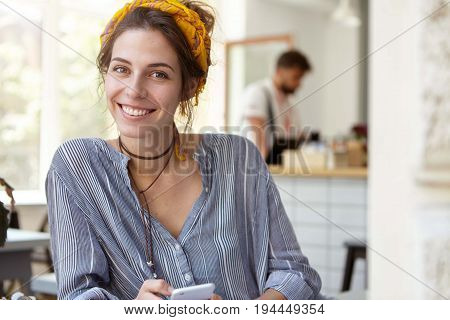 Beautiful Woman With Dark Eyes, Healthy Pure Skin And Broad Smile Wearing Yellow Scarf On Head And S