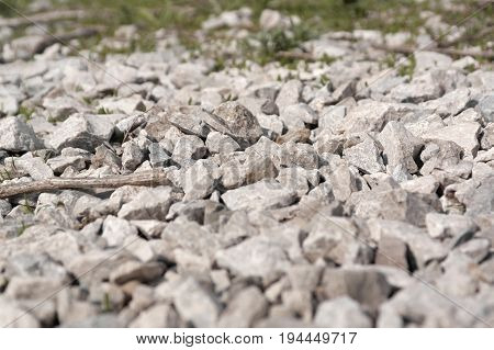 Abstract background from crushed stones shallow dof