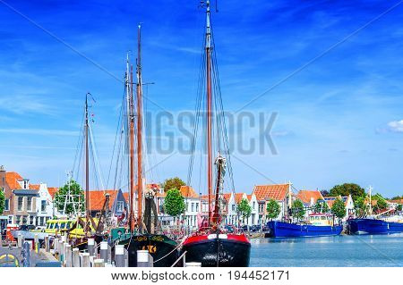 Dutch flat bottom boats sailing boats in a harbor in Holland Ziereksee. Province of Zeeland The Netherlands.