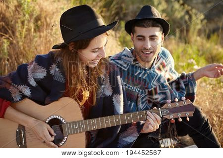 Talented Cute Female Musician Playing Guitar During Sunset Time Having Good Time With Her Husband Si