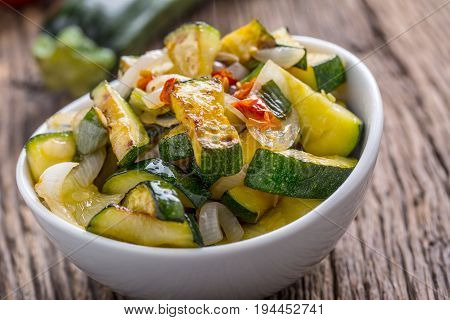 Zucchini. Zucchini salad. Grill Zucchini with onion an chili pepper. Salad with grill vegetable.