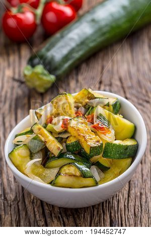 Zucchini. Zucchini salad. Grill Zucchini with onion and chili pepper. Salad with grill vegetable.