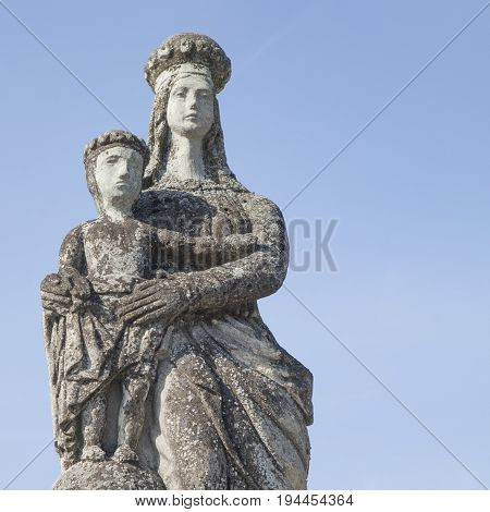 silver statue of the Virgin Mary with the baby Jesus Christ (Religion faith eternal life God the soul concept)