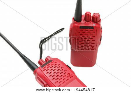 two red portable radios on white background