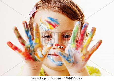 Beautiful little child girl and the painted hands. (art people childhood color drawing concept)