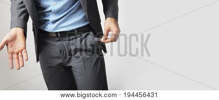 empty pocket as a symbol of the lack of money (poverty inflation financial crisis)