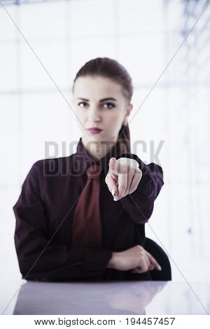 portrait of a beautiful business woman pointing at you (Body language gestures psychology)