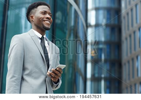 Salesman with smartphone in the city