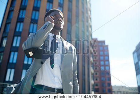 Elegant man in suit and tie calling outdoors