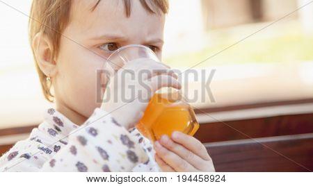 Vitamin C orange fruit drink for attractive pretty baby girl