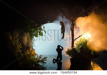 Horror View Of Hanged Girl On Tree At Evening (at Night) Suicide Decoration. Death Punishment Execut