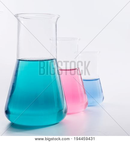 science and clinic background. Chemical and Medical laboratory research.  laboratory beakers with colorful liquids and reagents.