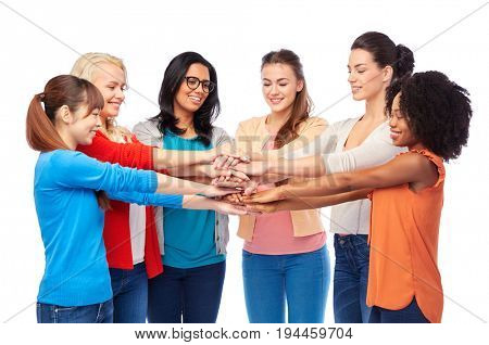 diversity, race, ethnicity, community and people concept - international group of happy smiling different women over white holding hands together