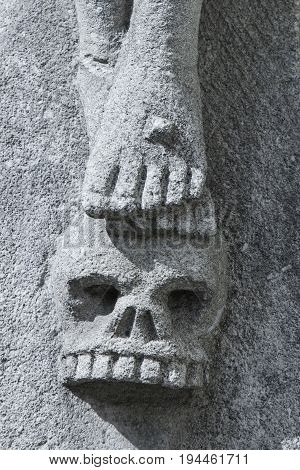 The skull of first man Adam was buried at the place where later was crucified Jesus Christ (the biblical tradition theology symbol Christianity faith concept). Fragment of statue.