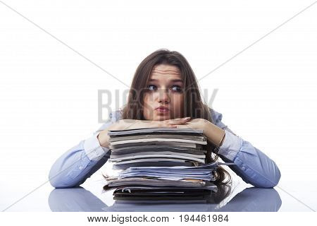 Businesswoman in problems. Alone working in office with a lot of documents. Yelling and screaming for bad results. (psychological portrait aggression anger frustration)