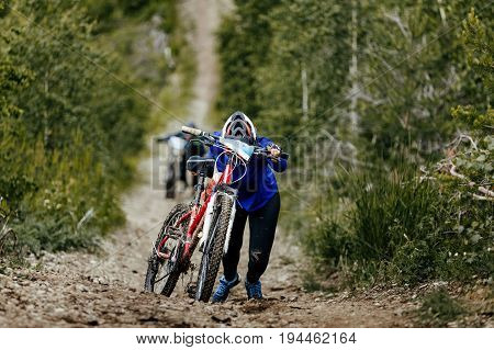 athlete cyclist mountain bike uphill in mountain trail