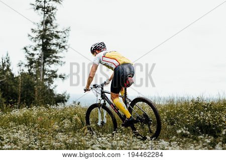 male athlete cyclist mountain biking competition cross-country