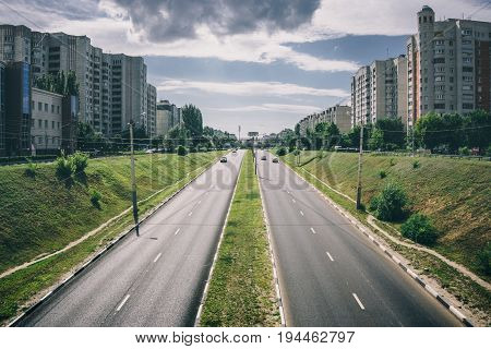 Asphalt highway road in Voronezh city, Russia. Urban Transportation concept, cityscape, urban skyline, toned