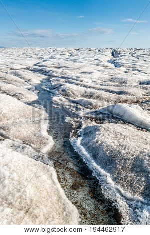 Melting ice in top surface of a glacier Svalbard